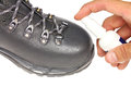 Processing Trekking Shoe With A Protective Spray Stock Images - 32032554