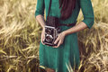 Brunette Girl With Retro Camera In Meadow Royalty Free Stock Photo - 32037755