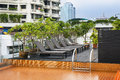 Orange Swimming Pool On Rooftop With Modern Building. Stock Photography - 32040242