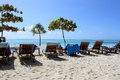 Zanzibar White Sandy Beach And Wooden Chairs Stock Photography - 32046102