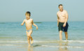 Happy Father And His Son On The Sea Royalty Free Stock Images - 32049659