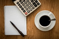 Open A Blank White Notebook, Pen And Cup Of Coffee And Calculator Royalty Free Stock Image - 32054146