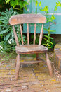 Old Wooden Chair In A Garden Royalty Free Stock Images - 32063989