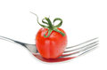 Fresh Cherry Tomato On A Fork Isolated Stock Photography - 32087522