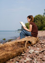 Reading At The Beach Stock Image - 3217541