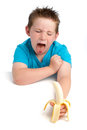 Yound Boy Not Happy About Eating A Banana. Royalty Free Stock Photo - 32127845