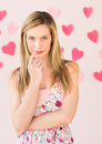 Shy Woman With Heart Shaped Papers Against Colored Background Royalty Free Stock Image - 32145866