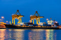 Container Cargo Freight Ship With Working Crane Bridge In Shipya Stock Images - 32156814