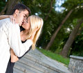 Young Couple Kissing Outdoors Royalty Free Stock Images - 3223459