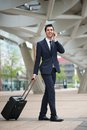 Young Business Man Traveling With Bag Stock Photography - 32203552