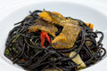 Black Spaghetti With Fired Fish Royalty Free Stock Image - 32220146