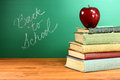 Back To School Books And Apple With Chalkboard Royalty Free Stock Photo - 32220215