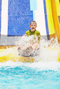 Boy Shouts While Slides Down Water-slide Stock Image - 32223851