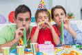 Beautiful Family Playing With Party Horns Stock Images - 32233524