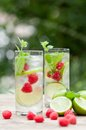 Fresh Cold Drink Water Ice Cubes Peppermint Lime Raspberry Royalty Free Stock Image - 32257176