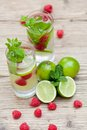 Fresh Cold Drink Water Ice Cubes Peppermint Lime Raspberry Stock Images - 32257184