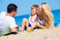 Family On The Beach Stock Image - 32266311