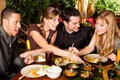 Young People Eating In Thai Restaurant Stock Image - 32267731
