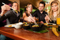 Young People Eating In Thai Restaurant Stock Images - 32267734