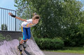 Roller Skater Speeding Down A Ramp Royalty Free Stock Image - 32275376