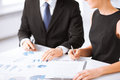 Business Team On Meeting Discussing Graphics Stock Images - 32283834