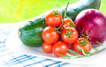 Zucchini, Onion And Cherry Tomatoes Outdoor On White Plate Stock Photos - 32299603