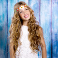 Blond Happy Hippie Children Girl Smiling On Blue Wood Stock Photography - 32314832