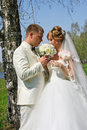 Bride And Groom With Flowers Stock Photography - 32331152