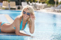 Having Fun On The Poolside. Side View Of Beautiful Young Women I Stock Image - 32333481