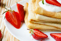 Crepes With Sour Cream And Fresh Strawberries Stock Photography - 32336762