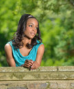 Beautiful Young African American Woman Standing Along Stone Wall Royalty Free Stock Photos - 32349158