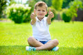 Cute Little Boy Sitting On The Grass Royalty Free Stock Photo - 32375505