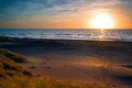 Sunset Over Sea And Sand Dunes Royalty Free Stock Images - 32390649
