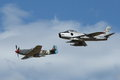 F-86 Sabre And P-51 Mustang In Formation Royalty Free Stock Photo - 32397685