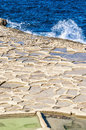 Salt Pans Near Qbajjar In Gozo, Malta. Stock Photography - 32404612