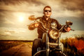 Biker On A Motorcycle Royalty Free Stock Images - 32416299