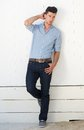 Handsome Male Fashion Model Standing Against White Wall Outdoors Royalty Free Stock Photography - 32435287