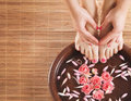 A Spa Composition Of Feet And Hands In A Bowl Royalty Free Stock Photography - 32462797