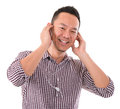 Asian Man Listening To Mp3 Stock Images - 32465004