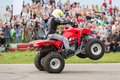 Kid Rides On The Rear Wheels On A Quad Bike Stock Photo - 32482950