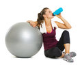 Fitness Young Woman With Fitness Ball Drinking Water Royalty Free Stock Image - 32484146