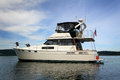 Anchored Cabin Cruiser Stock Photo - 32508220