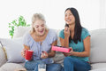 Friends Sharing A Box Of Chocolates And Laughing Royalty Free Stock Photos - 32514708