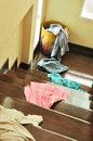 Lots Of Messy Clothes On A Cloth Basket And Stair Royalty Free Stock Photos - 32522098