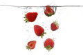 Strawberries Falling Into Splashing Clear Water Royalty Free Stock Photo - 32544665