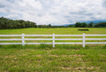 Fence In Farm Field With Cloudy Royalty Free Stock Photo - 32562835