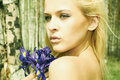 Beautiful Blond Woman With Blue Flowers In A Forest Stock Image - 32563371