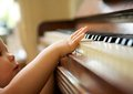 Portrait Of A Baby Playing The Piano Royalty Free Stock Photos - 32571518