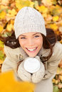 Autumn Woman Drinking Coffee In Fall Forest Royalty Free Stock Photos - 32583468