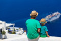 Father And Son Looking At Santorini, Greece Stock Photography - 32586172